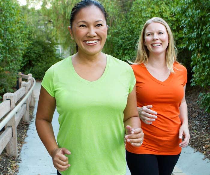 Two women walking photo