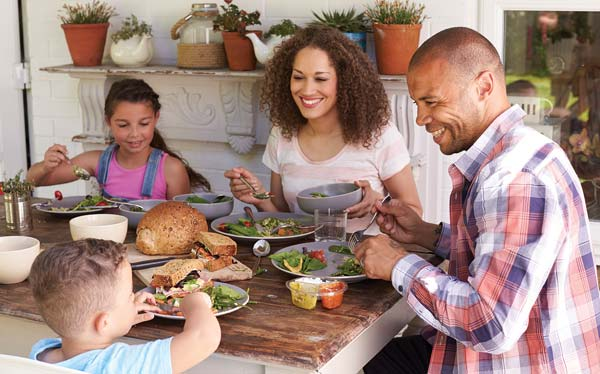 Family having dinner together photo