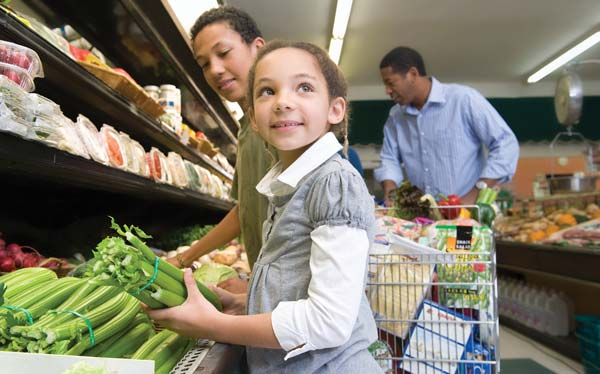 Family grocery shopping together photo